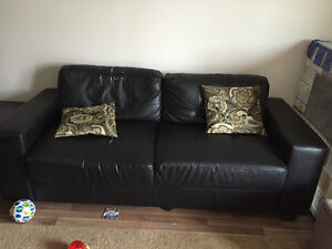 Black bonded leather couch and chair