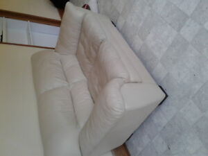 Beige leather love seat