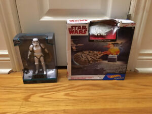 New in box Star Wars stormtrooper; millennium falcon hot wheel