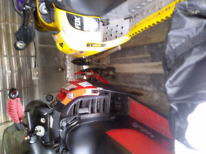 2 snowmobiles and enclosed trailer package.