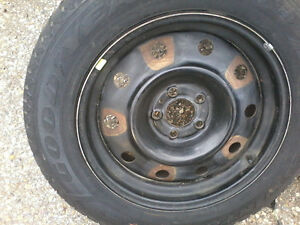 3- winter tires and rims goodyear nordic Chrysler 215-65-17in