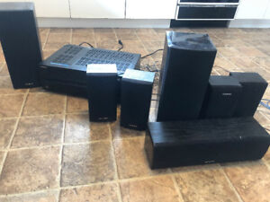 A variety of speakers and a receiver box for surround sound.