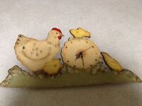 Old chicken and chick clock-working