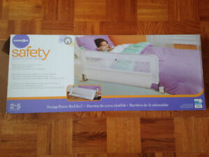 Swing down baby bed rail