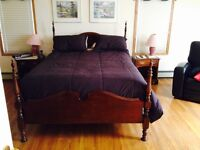 Solid Cherry Queen size poster bed and matching night stands