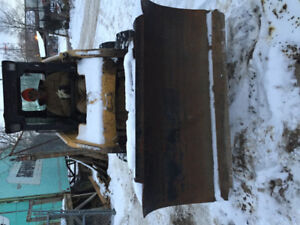 Snow plow for skidsteer