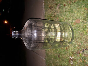 2 glass wine or beer carboys. Brewing bucket