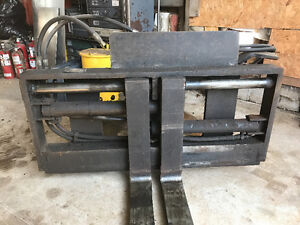 Forklift/towmotor attachment Fork positioner with side shift
