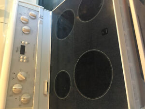 Whirlpool flat top stove in good working condition.