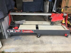 TILE AND STONE CUTTER/ELECTRIC SAW  LIKE NEW