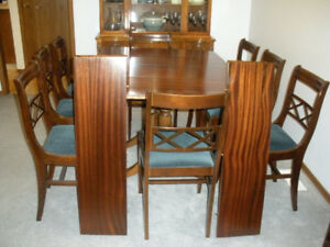Wood dining room table, china cabinet with eight chairs