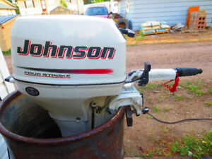 Like new 2004 Johnson 8 hp 4 stroke with fuel tank
