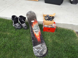 Brand new snowboard, brand new in box bindings, boots