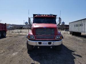 1997 Ford Louisville Tri Axle Dump Truck.