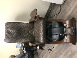 Massaging pedicure chair with additional nail supplies