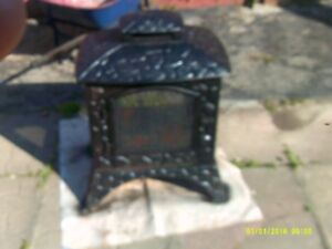 outdoor cast iron stove carved