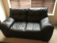 Dark brown leather sofa for a quick sale