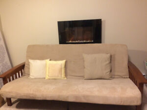 Solid wood futon couch in excellent condition