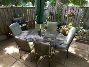 Patio table- wrought iron- with six chairs.