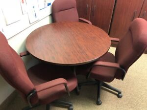 round office table and 3 chairs