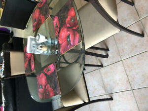 Gently used bowring glass rounded square table (no chairs)