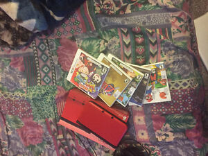 Red 3DS XL mint with original box and games