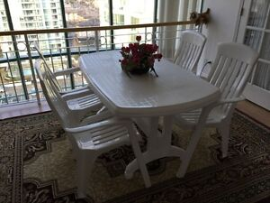 Large patio table and 4 chairs (bonus side table)