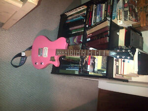 Pink first act electric guitar 75.00 or best offer