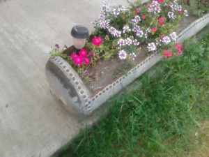 Old water heater tank planter
