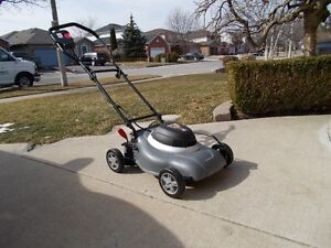 NEW COMPACT ELECTRIC MOWER $125.00