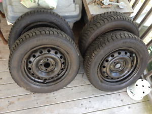 Like new used winter tires size 14R/185/65