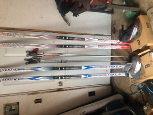 * NEW Salomon his and hers skis packages