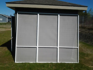 Screened garage door