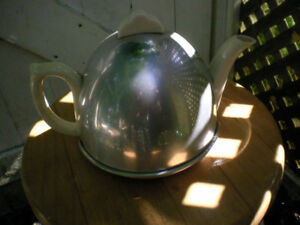 Vintage teapot with aluminum cover