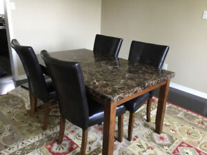A dining table & 4 chairs