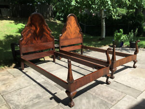 A pair of antique twin beds