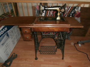 Antic Singer sewing machine and cabinet