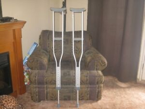 PAIR OF ADJUSTABLE CRUTCHES IN NEW CONDITION