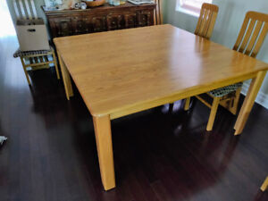 Lazy Sue for sale with quare dining room table.