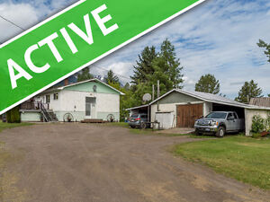 HOUSE WITH ACREAGE MINUTES FROM TOWN