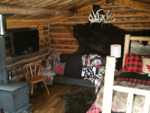 100+ year old log cabin for rent out near Ghost Lake