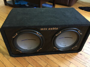Two 12 inch jackhammer subwoofers in box, small crack in one