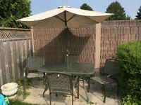 Patio table with umbrella/stand - four chairs