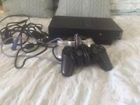 PlayStation 2 slim - leads and 2x controllers and around 20 games £45