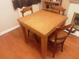 Extending solid oak dining table and 4 chairs