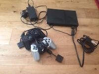 PlayStation 2 console with 3 games