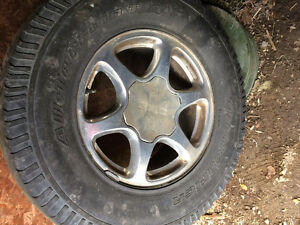 4 all season GMC tires on rims , with centres