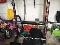 Squat Rack, Bench, 137.5kg olympic size Plates, 7ft olympic Bar, 4ft olympic EZ bar,