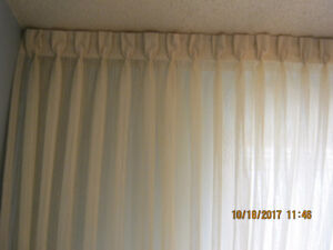 pleated drapes and double track