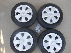 P185/65R14 Michelin Defender Tires on Nissan Versa Steel Rims